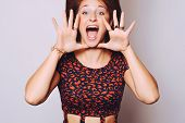 stock photo of screaming  - Beautiful young woman shouting and screaming isolated over plain background - JPG