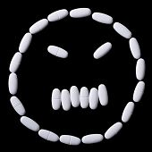 stock photo of oblong  - face of white oblong tablets on a black background - JPG