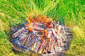 foto of bonfire  - Bonfire at a camp in natural surroundings - JPG