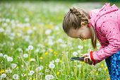 Little Girl Exploring Nature With Her Smartphone poster