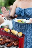 pic of frazzled  - Woman being on diet refusing grilled sausage - JPG