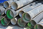 stock photo of septic  - Ceramic and PVC sewer pipe on construction site - JPG