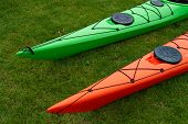 picture of kayak  - Colorful kayaks on the beach ready for extreme sport activity - JPG