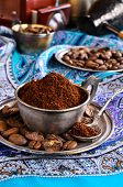 stock photo of coffee grounds  - Ground coffee is in a metal Cup - JPG