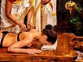 stock photo of panchakarma  - Young woman having body Ayurveda spa massage - JPG