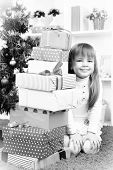 pic of little girls photo-models  - Little girl with presents near Christmas tree in room - JPG