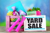 stock photo of yard sale  - Crate of unwanted stuff ready for yard sale on bright background - JPG