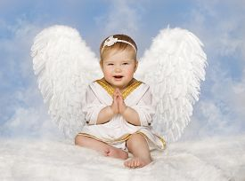 foto of cupid  - Angel Baby Wings Angelic Cupid Toddler Kid Clasped Hands Folded New Born Child Sitting at Blue Sky Cloud - JPG