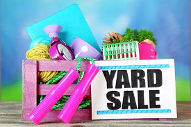 image of yard sale  - Crate of unwanted stuff ready for yard sale on bright background - JPG