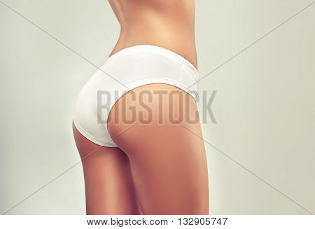 poster of Slim tanned woman   Perfect Body  .Taut elastic ass . Firm buttocks .  Slim toned young body of the girl . An example for sports and fitness or plastic surgery and aesthetic cosmetology