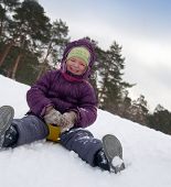 foto of snow-slide  - The boy goes for a drive on an ice slope - JPG