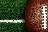 American football on football field background poster