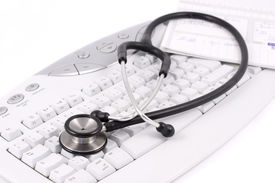 picture of medical office  - stethoscope and medical record lying on a keyboard - JPG