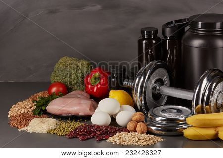 poster of Sports  nutrition (supplements), healthy food and dumbbells  on a black background. Fitness, bodybui