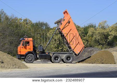 The Dump Truck Unloads Rubble