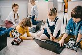 Kids Programming Diy Robots With Laptops While Sitting On Floor, Stem Education Concept poster