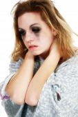 stock photo of depressed teen  - Teen girl in hospital gown over white background - JPG