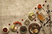 Wild Dry Rowan Berry Medicinal Tincture And Medical Shelf Fungus Betulinus On Sackcloth Background W poster