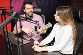 Young Hispanic Male And Female Host Moderating A Live Radio Show At Radio Station poster