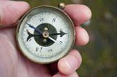 Traveler Holding Compass In Hand. Compass In A Hand Blurred Background poster
