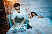 Adult Businessman Works At Night At Home. Successful Trader Analyzing Charts Of Currency Pairs. Expe poster
