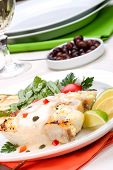 foto of halibut  - Grilled halibut with capers and pepper sauce served with grilled zucchini lemon lime tomatoes - JPG