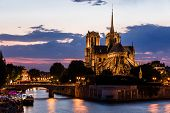View Of Southern Facade Of Notre Dame De Paris From The Seine River At Night. Notre Dame Cathedral   poster
