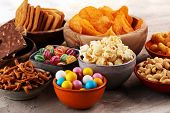Salty Snacks. Pretzels, Chips, Crackers In Wooden Bowls. poster