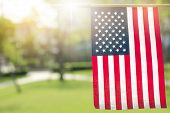 American Flag With Bokeh Natural Background And Sunlight For Memorial Day Or 4th Of July. poster