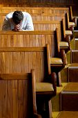 picture of repentance  - A man praying in church in natural light - JPG