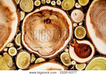poster of Stack Of Sawn Logs Background House Interior. Natural Wooden Decor Background. Stacked Of Wood Log T