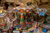Amusement Park In Miniature With Carousels In Winter poster