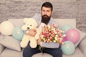 Romantic Gift. Macho Getting Ready Romantic Date. Man Wear Blue Tuxedo Bow Tie Hold Flowers Bouquet. poster
