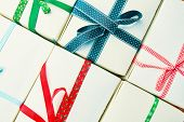 Stack Of Gift Wrapped Christmas Presents. Pile Of Presents Is Stacked Neatly On The Table. View From poster