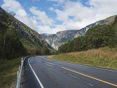 Winding Road E136 With Mountain Massif Trolltindene, Troll Wall Trollveggen, The Tallest Vertical Mo poster