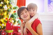Happy Family And Merry Christmas. Mother And Baby Son At Christmas Morning At Tree Decorating And Ch poster