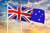 Relationship Between The United Kingdom And The Australia. Two Flags Of Countries On Heaven With Sun poster