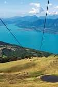 Aerial View Of The Lake Garda With Green Pastures In Italian Alps, Photographed From Monte Baldo. Ve poster