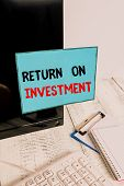 Writing Note Showing Return On Investment. Business Photo Showcasing Ratio Between The Net Profit An poster