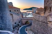 Old City Walls And Old Harbour Of Dubrovnik At Sunset In Dubrovnik, Croatia poster