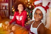 Smiling Cute girl in front of decorated Christmas tree.family celebrating Christmas together. poster