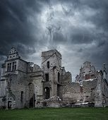 stock photo of manor  - Stormy sky over ruins of manor house - JPG