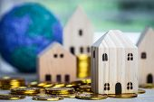 Home Real Estate Mortgage Concept : House Miniature Model With Stack Money Coins Show For Selling. I poster