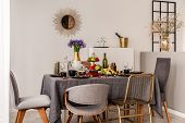 Elegant Dining Room Interior With Communal Table And Copy Space On Empty Wall poster