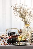 Common Dining Room Table With Food, Fruits, Cake And Flowers In Vase poster