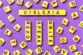 Dyslexia, Read Write Words Yellow On Pink Purple With Scattered Letters Cubes Around, Reading Diffic poster
