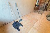 House Cleaning Equipment Such As A Mop With Rag In Apartment That Is Under Construction, Remodeling, poster