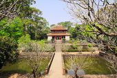 Ancient pavilion and ponds in Imperial Minh Mang Tomb of the Nguygen dynasty in Hue, Vietnam. UNESCO poster