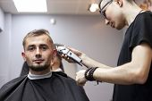 Young Guy Makes A Short Haircut In A Barbershop With A Trimmer, Close-up poster