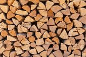 Firewood Background, Chopped Firewood On A Stack. poster